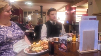 Elder Kinville enjoying his meal