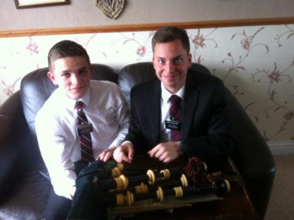 Elder Peterson and Elder Augustine looking at some very old bagpipes. Picture courtesy of Sister Stronach
